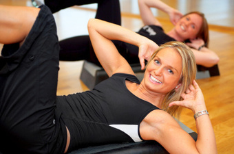 Image of a group corporate exercise class in session.
